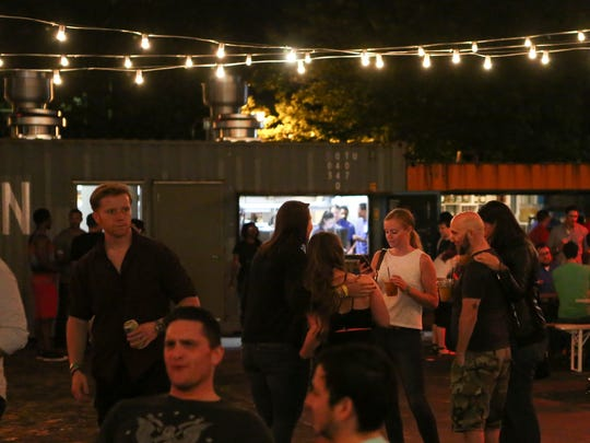 People relax during the first night of the Constitution Yards beer garden at the Wilmington Riverfront Friday.