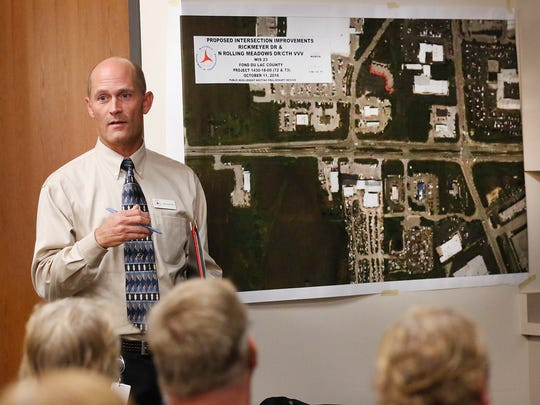 Wisconsin Department of Transportation's Robert Wagner talks to a group of citizens at the Fond du Lac County Airport Tuesday October 11, 2016, about a construction project taking place in 2019 on Highway 23 between Fond du Lac and Rosendale.