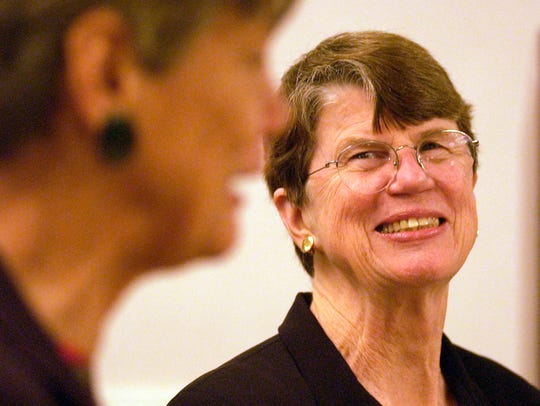 Former U.S. Attorney General Janet Reno (right) laughs