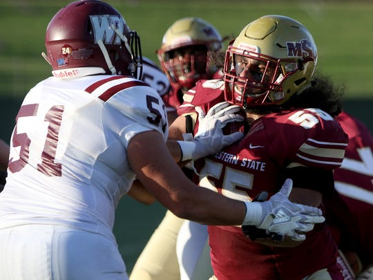 Midwestern State's Islam Sbeih blocks West Texas A&M's Trevor Myklebust Saturday, Oct. 21, 2017, at Memorial Stadium.