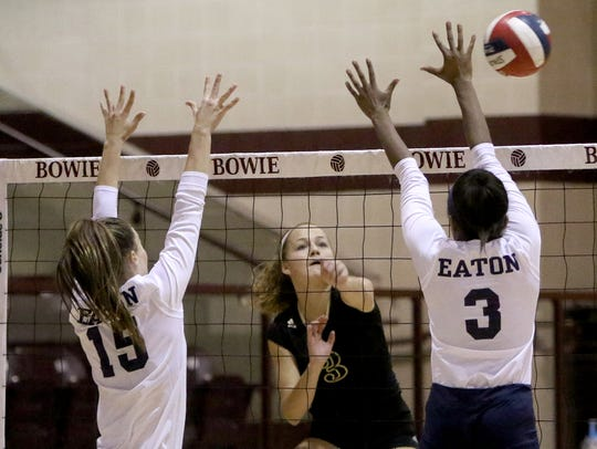 Rider's Emily Stolt spikes the ball past Eaton's Caleigh