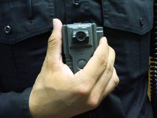 Horizon City police officer Joshua Gonzalez shows the