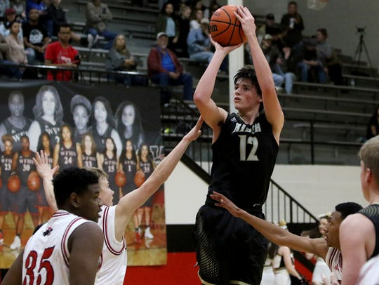 Rider's Ty Caswell shoots from three-point range in