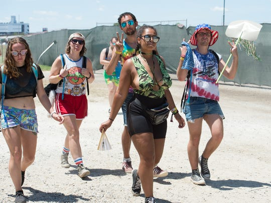Festival goers enter the Firefly Music Festival in