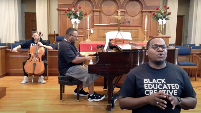 """Akron Symphony Orchestra principal cellist Erica Snowden-Rodriguez, Gospel Meets Symphony pianist Joseph Townsend and singer-songwriter Jonathon Turner, the Gospel Meets Symphony choirmaster, record Turner's song """"My Black is Beautiful."""""""