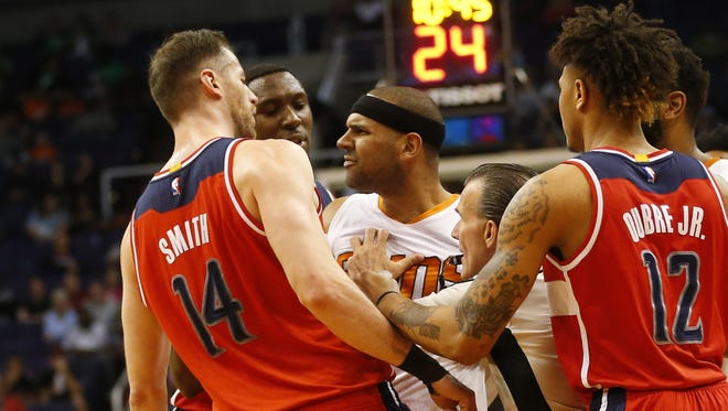 Phoenix Suns forward Jared Dudley (3) gets into an altercation with Washington Wizards forward Jason Smith (14) and Ian Mahinmi (center) during the second quarter at Talking Stick Resort Arena March 7, 2017.