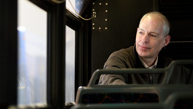 John Schaus rides a Valley Transit bus on Oct. 27, 2014 in Appleton.