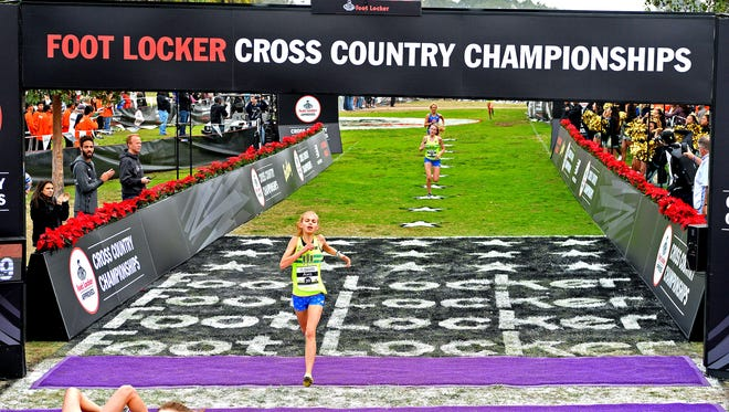 St. Philip High School senior Ava Strenge crosses the finish line at the 2016 Foot Locker Cross Country Championships on Saturday in San Diego, California.