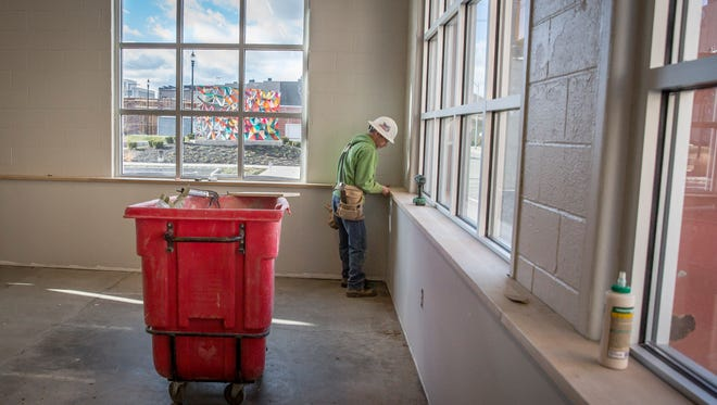 Work continues on the new space for Muncie's CO:LAB Thursday afternoon at Madjax in downtown Muncie. The CO:LAB is an open-concept coworking space for professionals of all types to brainstorm with one another, network and do business.