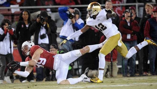 November 28, 2015; Stanford, CA, USA; Stanford Cardinal wide receiver Devon Cajuste (89) catches a pass against Notre Dame Fighting Irish cornerback Devin Butler (12) during the second half at Stanford Stadium. Mandatory Credit: Gary A. Vasquez-USA TODAY Sports