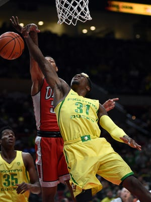 Oregon Ducks guard Dylan Ennis (31) has his shot blocked by UNLV Runnin' Rebels forward Troy Baxter Jr. (31) during the second half of the NCAA game at Moda Center. The Ducks won 83-63 on Dec. 17 2016, in Portland, Ore.