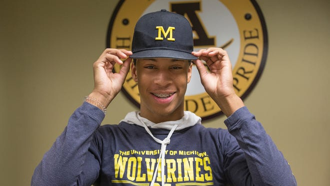 Michigan football signee Vincent Gray poses for a photo at Rochester Adams high school Wednesday.