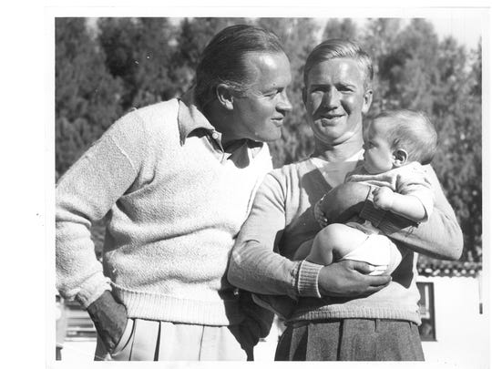 Bob Hope tries to entertain a very young Sammy Hagar in the arms of his father, Bob Hagar, in Palm Springs in the 1940s.