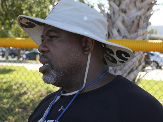 File: Steve Grant keeps an eye on his young football campers on Marco Island.