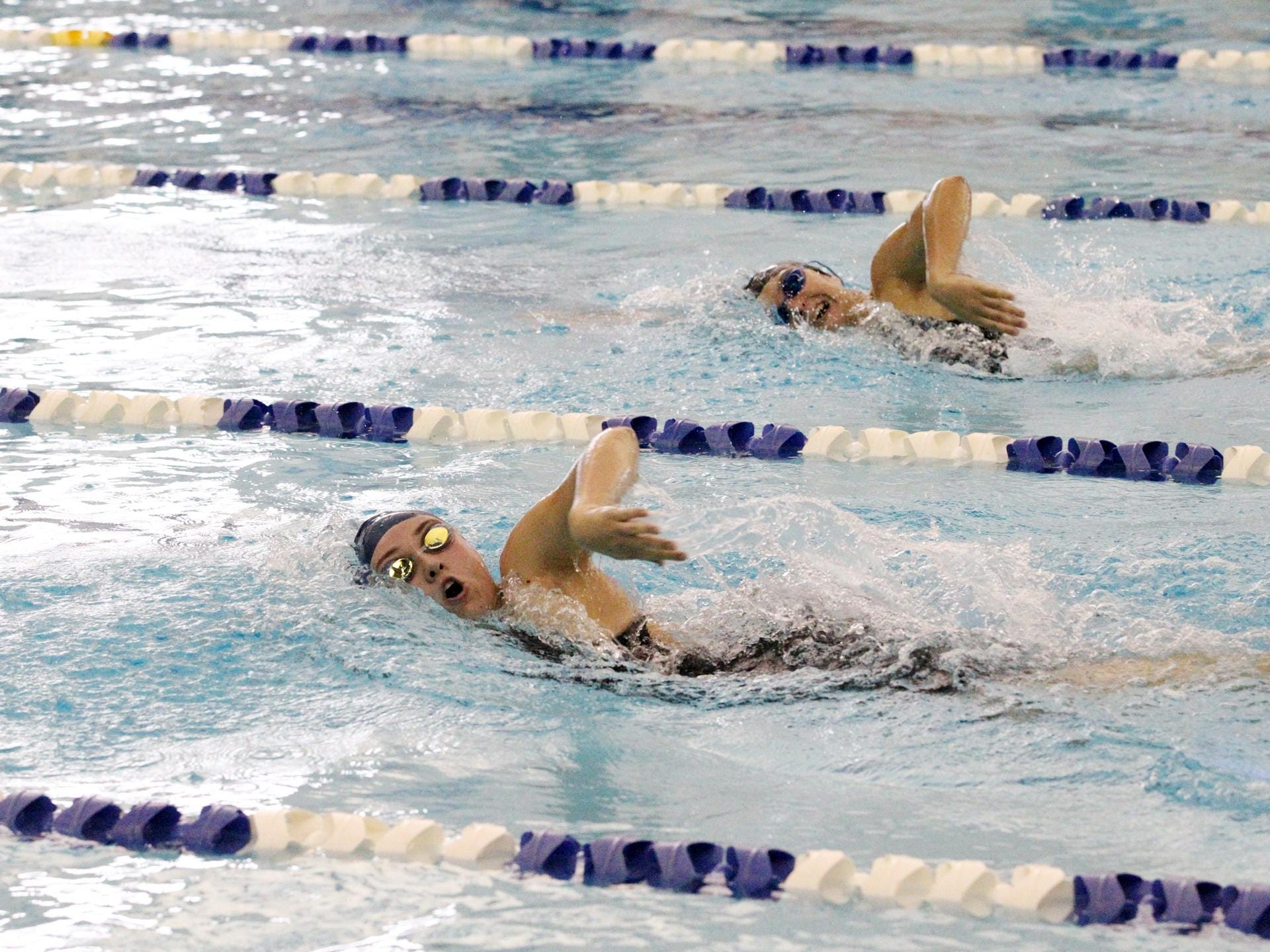 Battle Creek Central swimmer, Morgan Mowry, beats Lakeview swimmer, Alexandra Quada in the 200 Yard Freestyle event at The All-City Swim Meet Saturday morning