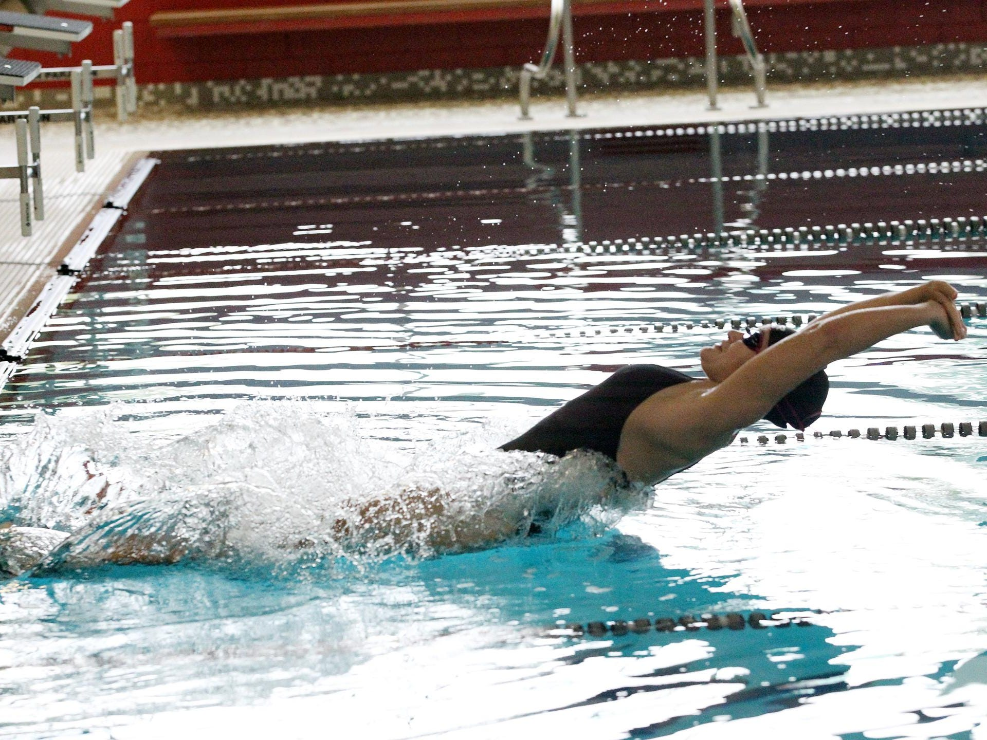 Heather Neitzka pracices her leg of the 200-Yard Medley Relay during Coldwater's mock meet Sunday evening.
