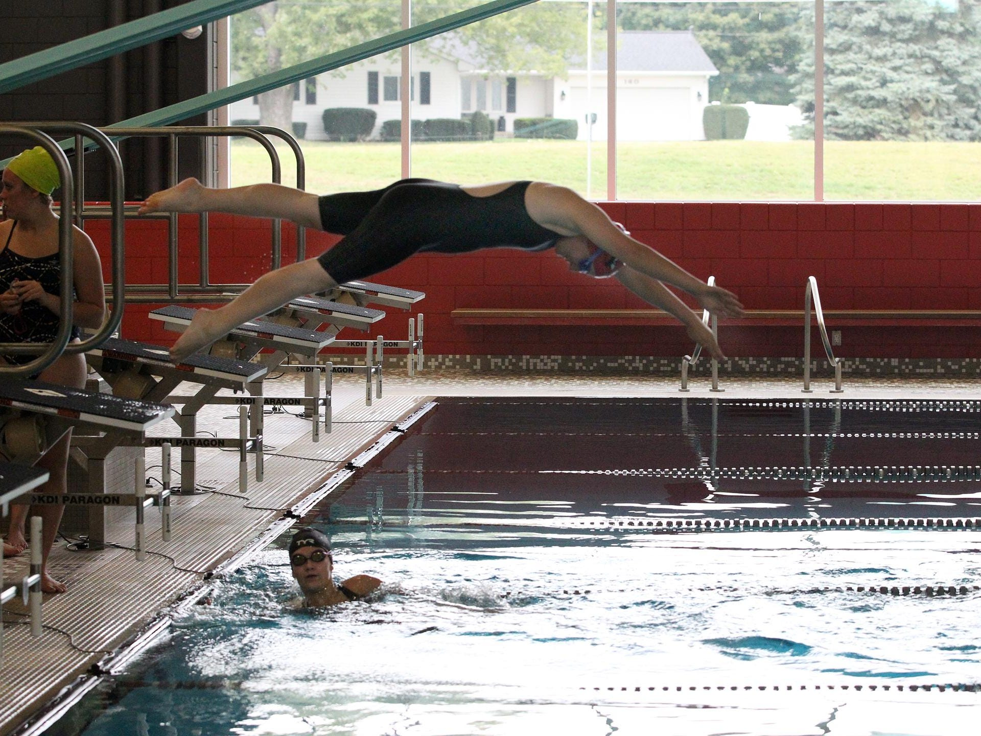 Kory Ulrich takes off as teammate, Heather Neitzka touches the finish during the 200-Yard Medley Relay at Coldwater's mock meet on Sunday.
