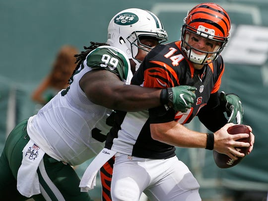 New York Jets defensive tackle Steve McLendon (99) sacks Cincinnati Bengals' Andy Dalton (14) during the first half of an NFL football game Sunday, Sept. 11, 2016 in East Rutherford, N.J. (AP Photo/Kathy Willens)