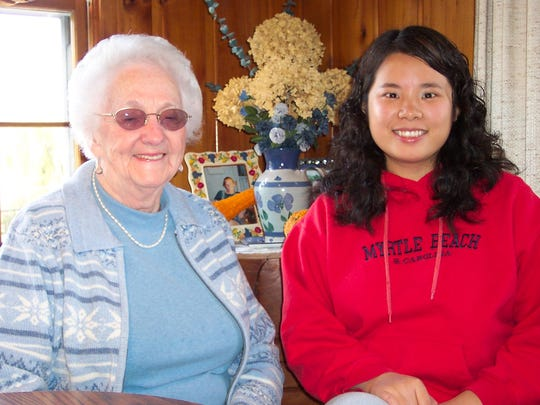 2005 photo: Left, Gerry and HomeShare guest Fei. Gerry hosted six Homeshare matches from 1988 to 2014.