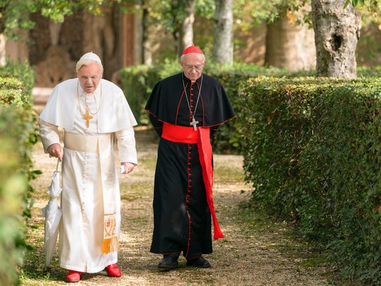 """Anthony Hopkins, left, as Pope Benedict and Jonathan Pryce as Cardinal Bergoglio in """"The Two Popes."""""""