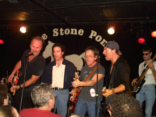 Joe Grushecky (left to right), Bob Benjamin, Michael J. Fox and Bruce Springsteen at the 2003 Light of Day at the Stone Pony in Asbury Park. Photo