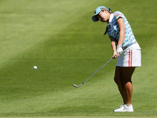 Bo-Mee Lee, of South Korea, chips to the ninth green during the third round of the LPGA Tour ANA Inspiration golf tournament at Mission Hills Country Club, Saturday, April 2, 2016, in Rancho Mirage, Calif. (AP Photo/Chris Carlson)