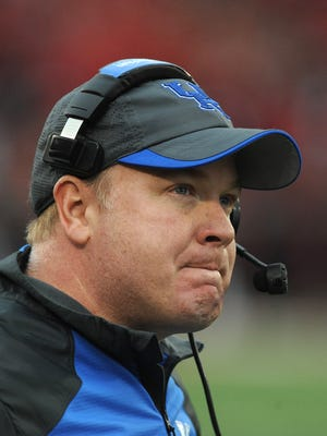Kentucky head coach Mark Stoops glances at the scoreboard late in the fourth quarter as the Wildcats take on Louisville on Saturday  at Papa John's Cardinal Stadium. (By David Lee Hartlage, Special to the C-J) Nov. 29, 2014.