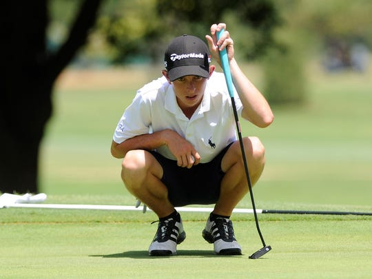 Merkel's Colton Hilburn lines up a putt during the second round of the AJGA Folds of Honor Junior Championship hosted by Bob Estes at the Abilene Country Club on Wednesday, July 18, 2018.