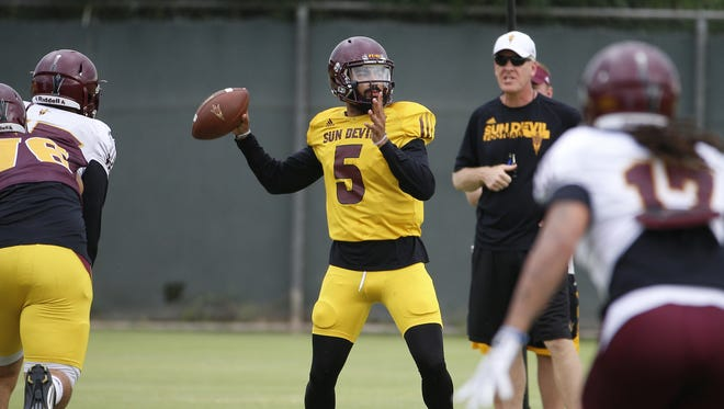 ASU's Manny Wilkins (5) passes during an outdoor practice at ASU on August 18, 2016 in Tempe, Ariz.