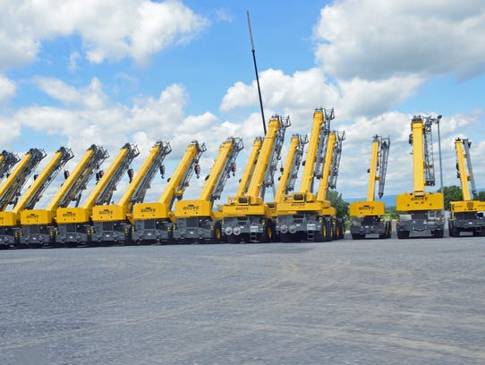 Cranes that are destined for customers are on display