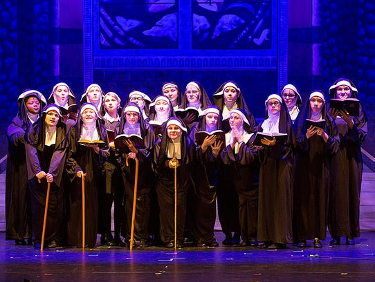 Fond du Lac High School students acting as nuns pose