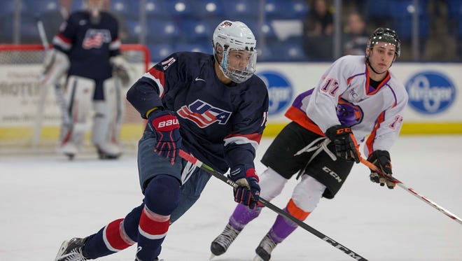 Team USA's K'Andre Miller skates down the ice at USA Hockey Arena in Plymouth.