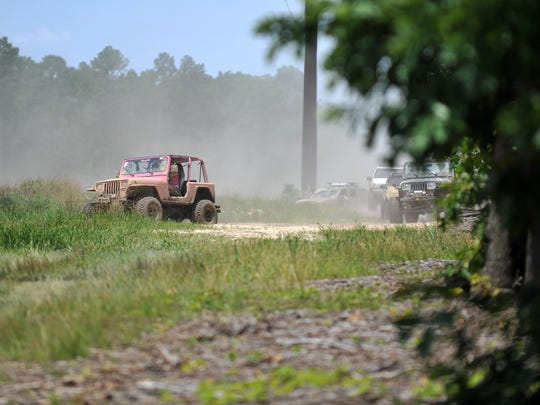 Jeeps and other trucks driving offroad.