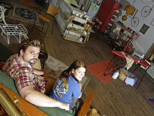 Greg Beam and Kristin Goins Gaffney sit in their thrift shop Step 22, formerly located on 17 E. Beverly St. in Staunton on June 20, 2005. The shop closed in 2008.