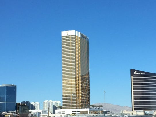 The shimmering golden hotel-condo development rises