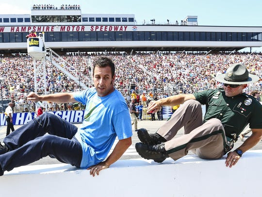Adam Sandler exits the track after telling drivers