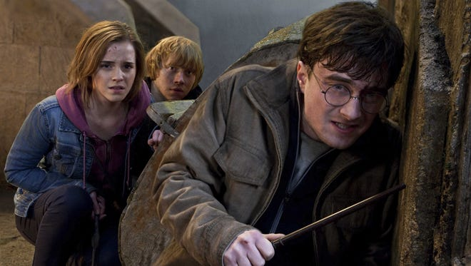 "The University of Iowa Lecture Committee is encouraging Iowans to write letters to Harry Potter author J.K. Rowling, asking her to speak in Iowa City next spring. From left, Emma Watson, Rupert Grint and Daniel Radcliffe appear in a scene from the film ""Harry Potter and the Deathly Hallows: Part 2,"" based on the final book in the series."