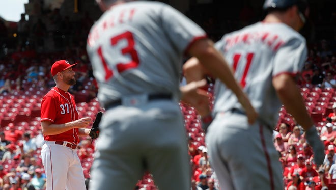 Cincinnati Reds starting pitcher Scott Feldman (37) stands on the mound after giving up a solo home run to Washington Nationals' Ryan Zimmerman, right, in the first inning of a baseball game, Monday, July 17, 2017, in Cincinnati.