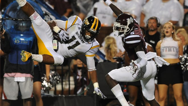 Southern Miss' Kalan Reed (11) picks off an interception from Mississippi State during their season opener against Mississippi State in Starkville.