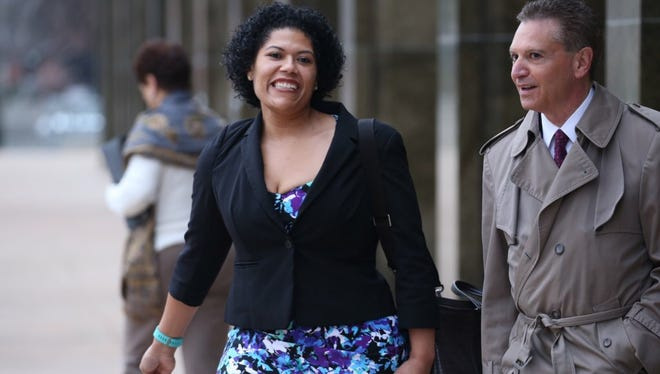 Rochester City Court Judge Leticia Astacio leaves court with her lawyer, Ed Fiandach, after being arraigned on a misdemeanor DWI charge on March 11, 2016.