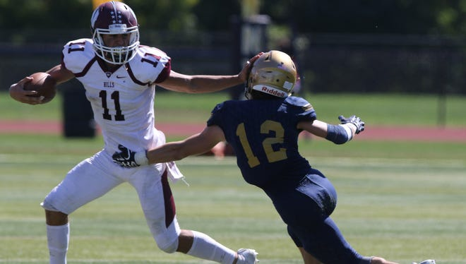 Wayne Hills QB Jaaron Hayek (11) rushed for 62 yards on 12 carries against NV/Old Tappan.