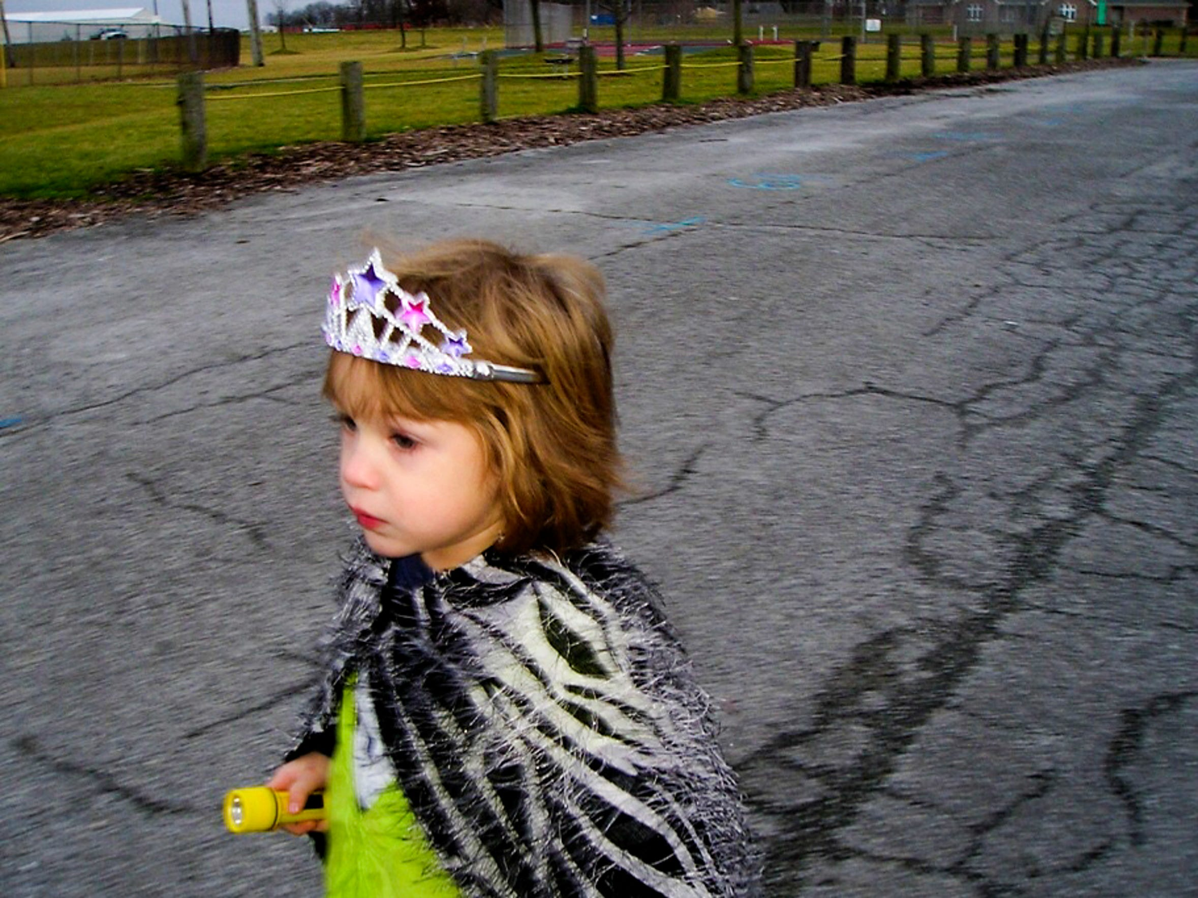Zay, 4, wears a cape her aunt made her and a tiara