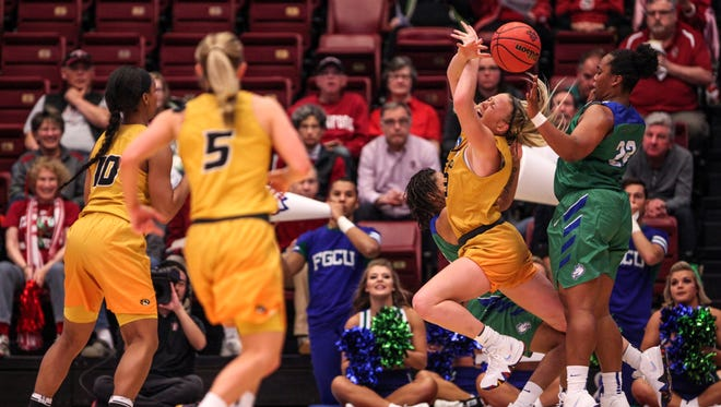 Missouri's Sophie Cunningham (3) trips as she is guarded by FGCU's Erica Nelson (11) and China Dow (22) during the second quarter of a first round NCAA tournament game at Maples Pavilion in Stanford, Calif., Saturday, March 17, 2018.