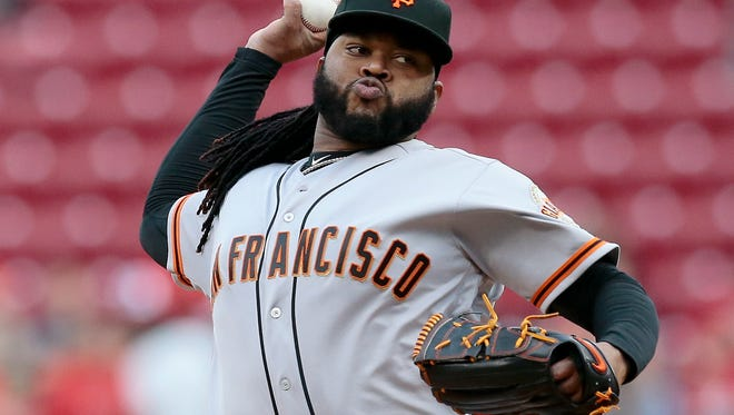 San Francisco Giants starting pitcher Johnny Cueto (47) delivers a pitch in the bottom of the first inning of the MLB National League game between the Cincinnati Reds and the San Francisco Giants at Great American Ball Park in downtown Cincinnati on Monday, May 2, 2016. The Reds led 6-3 after scoring six runs in the bottom of the third inning.