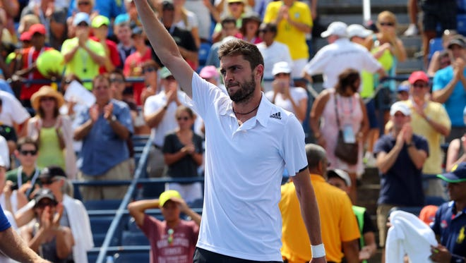 Gilles Simon (FRA) responds to the crowd after defeating David Ferrer (ESP) in four sets.