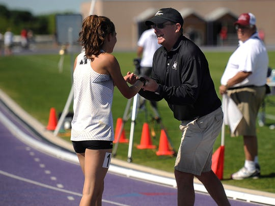 Abilene High football coach coach Del Van Cox congratulates Ashton Endsley after the standout distance runner won the girls 1600-meter run during the Districts 3/4-6A area track meet on Friday, April 22, 2016, at Abilene Christian University's Elmer Gray Stadium.