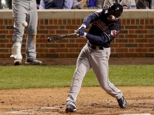 Cleveland Indians' Coco Crisp hits a RBI-single against the Chicago Cubs during the seventh inning of Game 3 of the Major League Baseball World Series Friday, Oct. 28, 2016, in Chicago. (AP Photo/Charles Rex Arbogast)