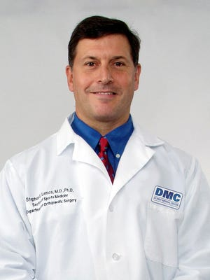 Dr. Steve Lemos directs the DMC Sports Medicine program and is team doc for the Detroit Pistons and Tigers.