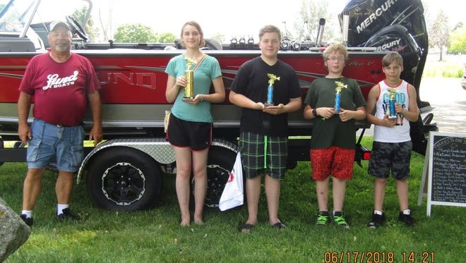 A group of children at Kids Fishing Day pose with trophies awarded June 17, 2018.