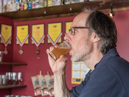 Jeff Robinson, owner of Third Monk Brewing Company, samples his Bellingham Saison.